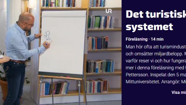 Robert Pettersson förläser om det turistiska systemet i UR